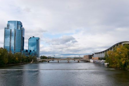 Grand Rapids, Michigan and the Grand River with beautiful glass sky scrapers and bridge.