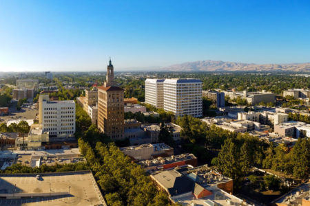 View of downtown San Jose, California, the capitol of Silicon Valley and high tech center of the world, on a sunny day with blue sky and mountains..