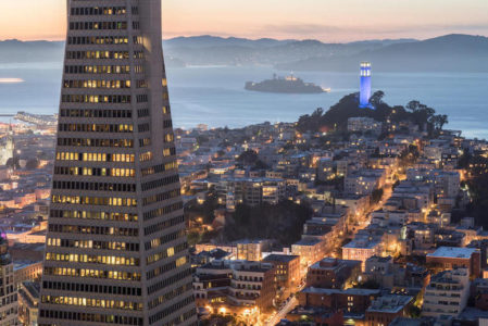 Dusk over Telegraph Hill, Alcatraz Island and San Francisco Bay in San Francisco from the Financial District.