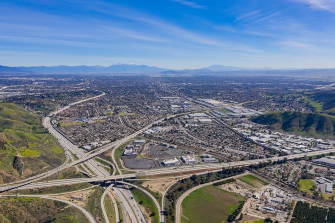 Aerial view of highway and cityscape of Pomona at California