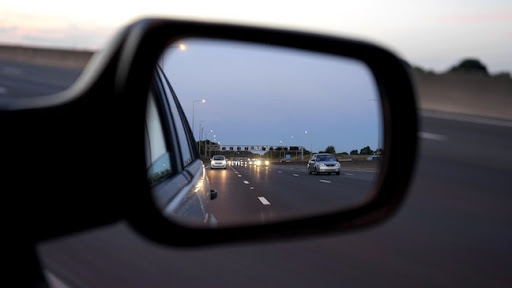view from side mirror on highway