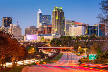 Downtown Raleigh, North Carolina city skyline with car tail lights..