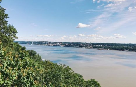 View of he Hudson River toward Yonkers, New York from the New Jersey Palisades with blue sky.