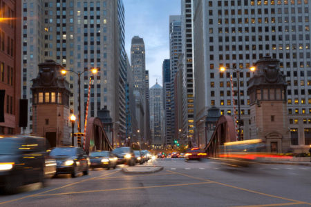 La Salle Street in downtown Chicago, Illinois at twilight with traffic.