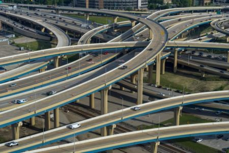 Freeway interchange in Milwaukee, Wisconsin with traffic.