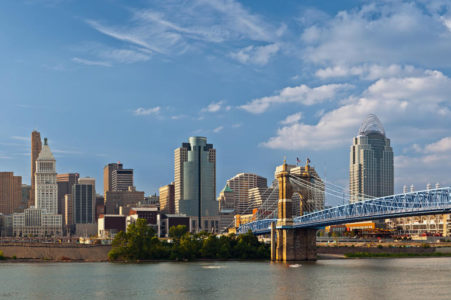 Cincinnati, Ohio skyline with historic John A. Roebling suspension bridge cross Ohio River.