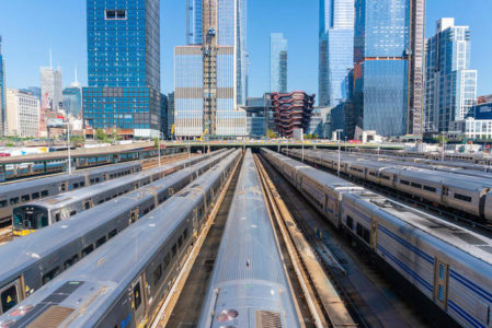 Subway trains in the Hudson Yards with Manhattan skyline in New York.