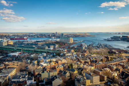 Aerial view of Boston, Massachusetts with Atlantic Ocean and blue sky.