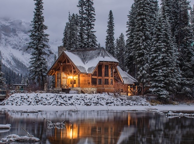 pictures of modern cottage surrounded by snow, trees and mountains