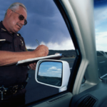 officer writing a ticket for speeding