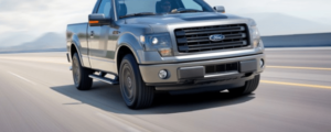 Ford_F150_Truck_driving_on_road