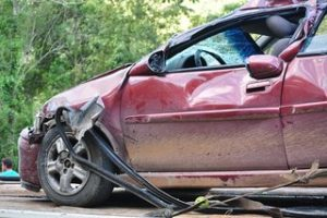 who covers a car crash damage in a no-fault state?