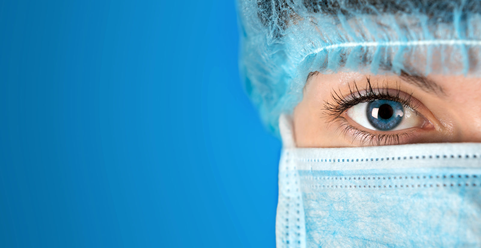 Woman in surgical mask.