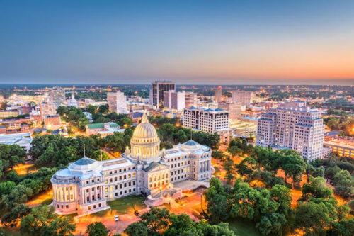Jackson, Mississippi, USA cityscape at dusk with sunset