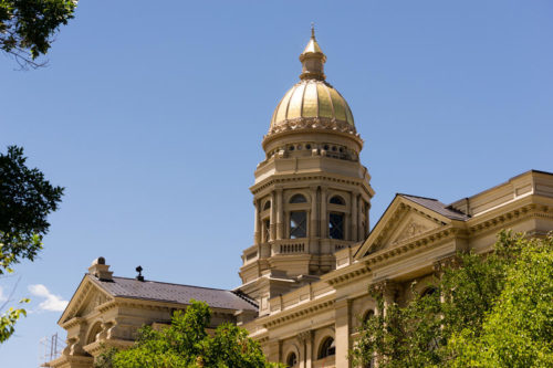 Downtown Capitol Building Legislative Center in Cheyenne, Wyoming during summer with blue sky and green trees