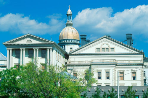 New Jersey State Capitol in Trenton, New Jersey during summer with blue sky and green trees