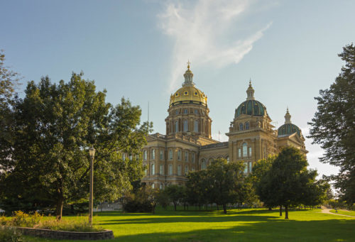 Side view of De Moines State Capitol Building in Des Moines, Iowa during summer