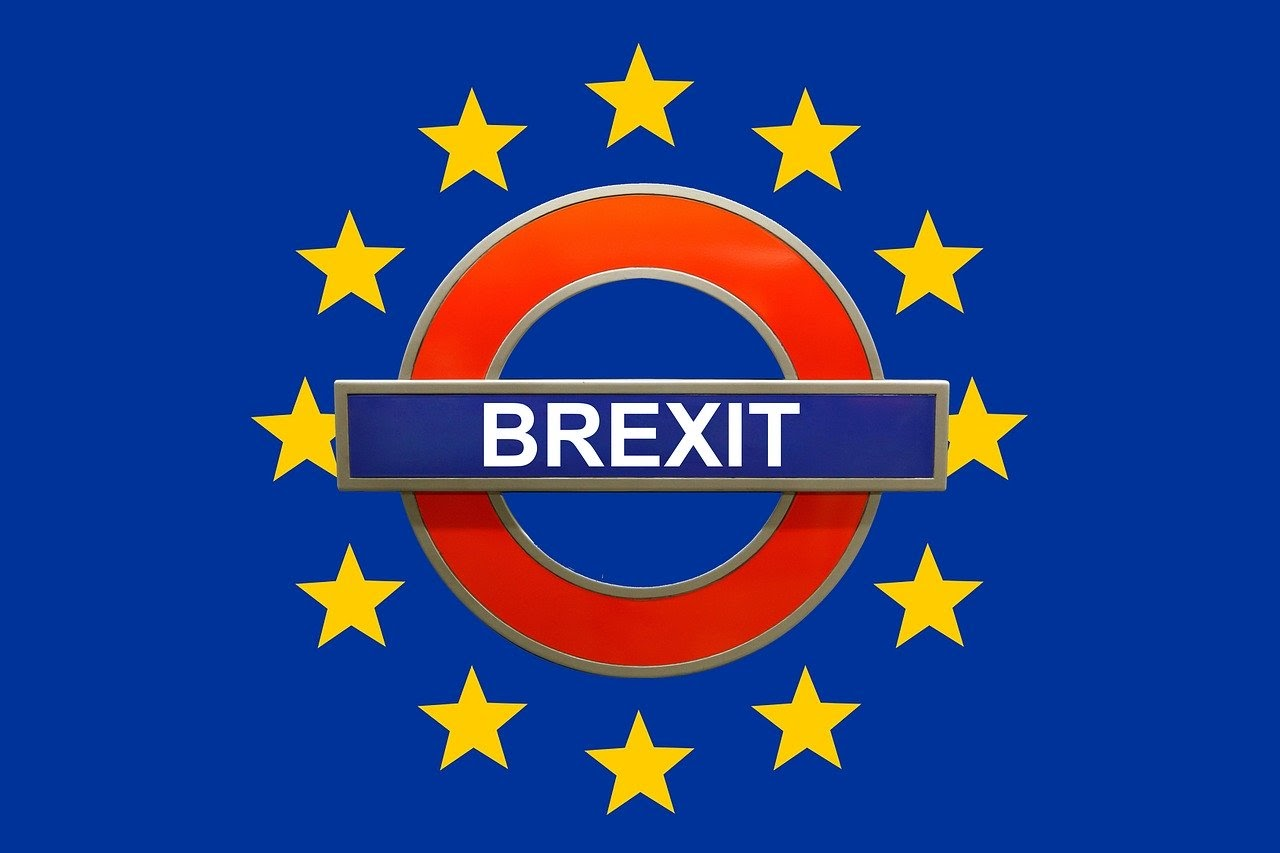 brexit logo surrounded by red circle, yellow stars, blue background