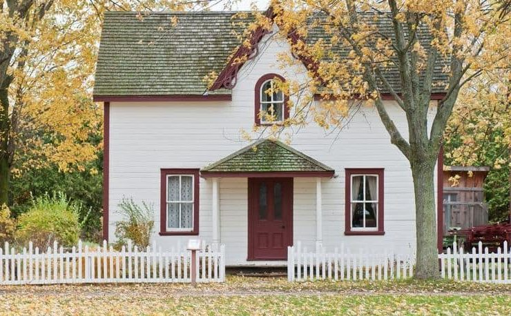 white house, red trim, tree, leves, white fence, bushes, windows