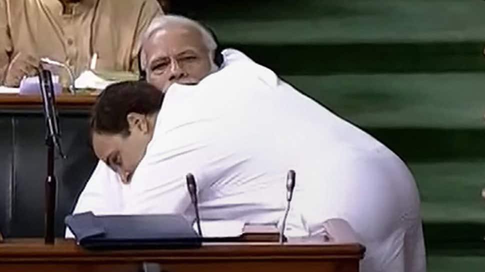 705627-rahul-hugs-modi-pti