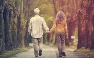 couple walking through trees