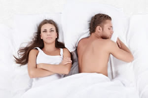woman in bed annoyed
