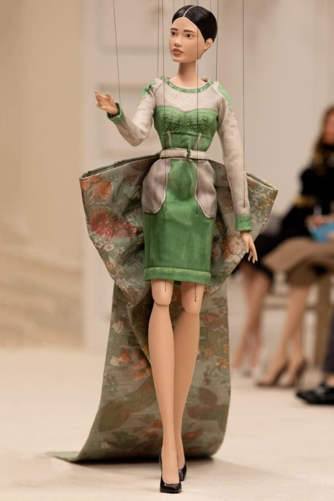 puppet model on the runway for Moschino fashion show during the pandemic