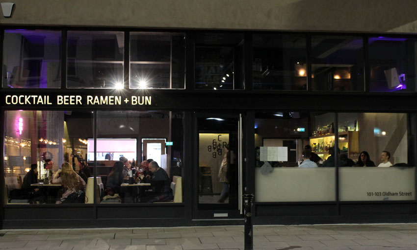 Cocktail Beer Ramen + Bun restaurant/></p> <p>There's been so many new openings in Manchester this past 12 months and I have a list as long as my arm of new places to try, but the first one I thought I'd tick off was a new bar called <strong>Cocktail Beer Ramen + Bun</strong>, a chic little place on Oldham Street serving ramen, small plates and bao buns.</p> <p>Harry went for Tonkotsu Ramen – he's becoming a bit of a ramen connoisseur, he said it was very good although not as good as his own!</p> <p><img src=
