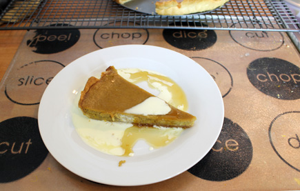 Pumpkin Pie with cream and maple syrup