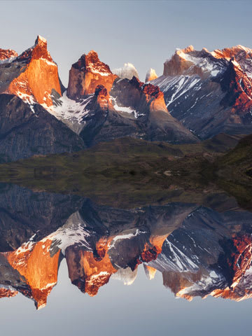Mountain range Torres Paine reflected in clear water