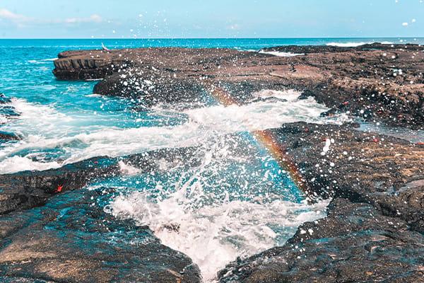 Water splashing forming rainbow galapagos