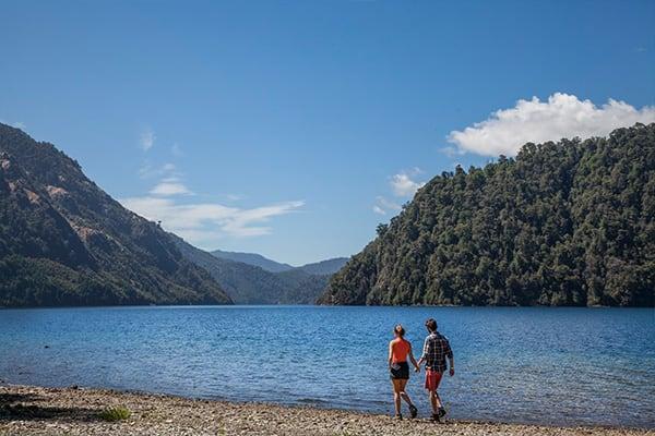 Couple Walking Lakeside Chile