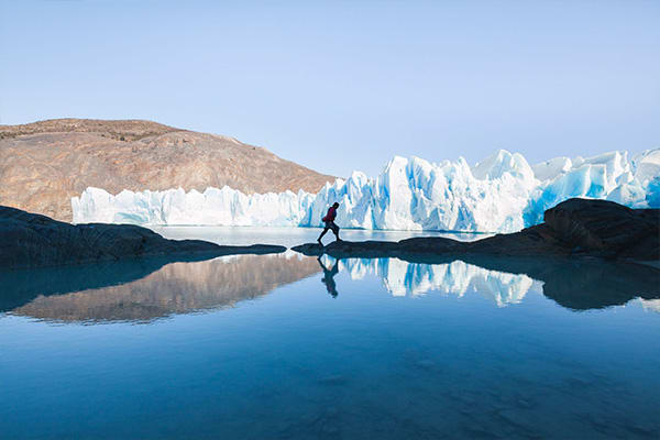 Man Walking in front of Glacier Chile