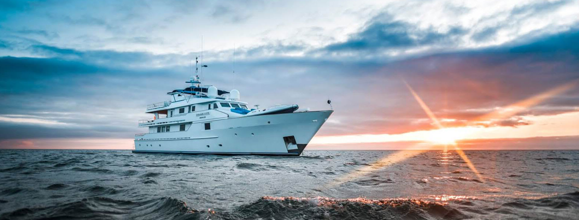 Ship at sea at sunset