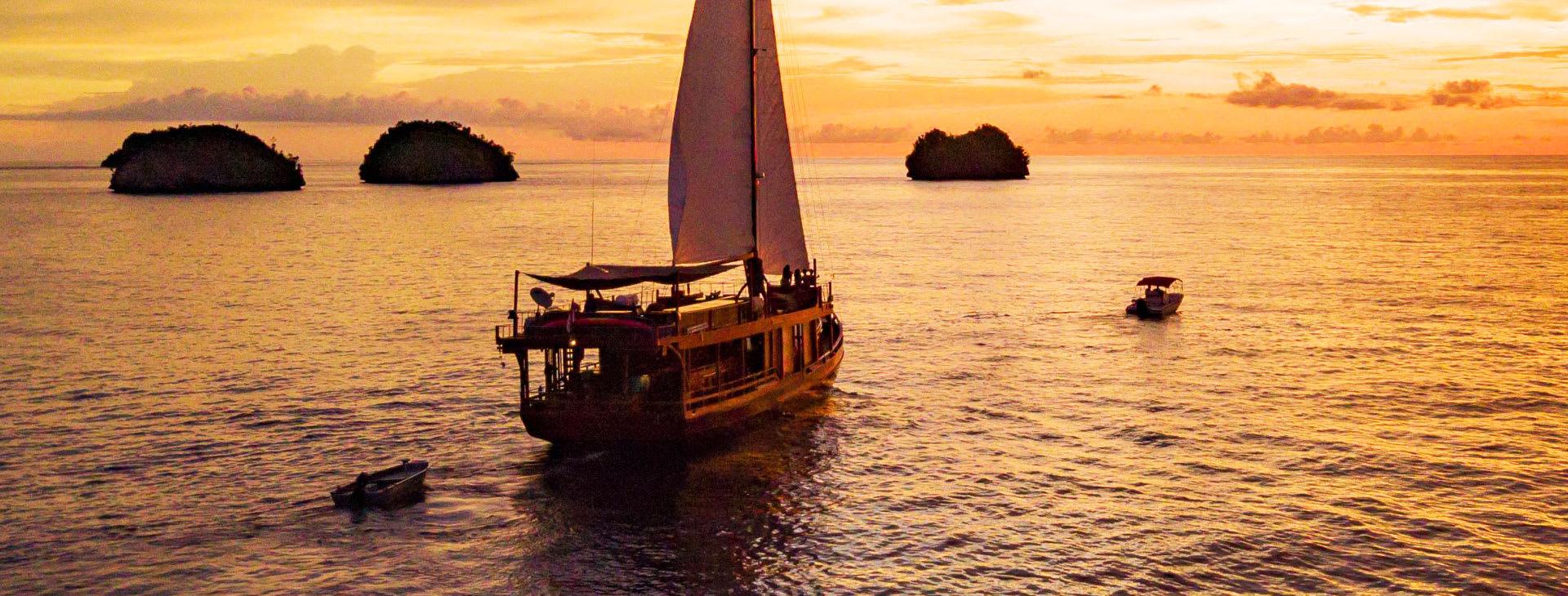Sailing ship at sunset