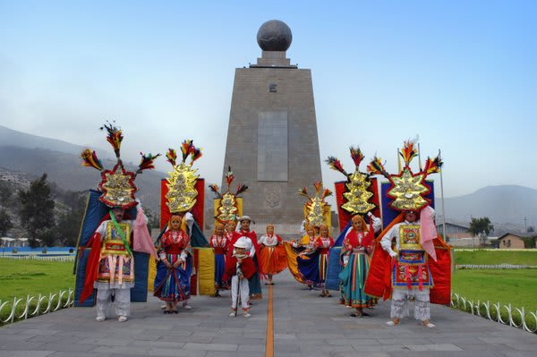 Middle World Monument with costumed people in front