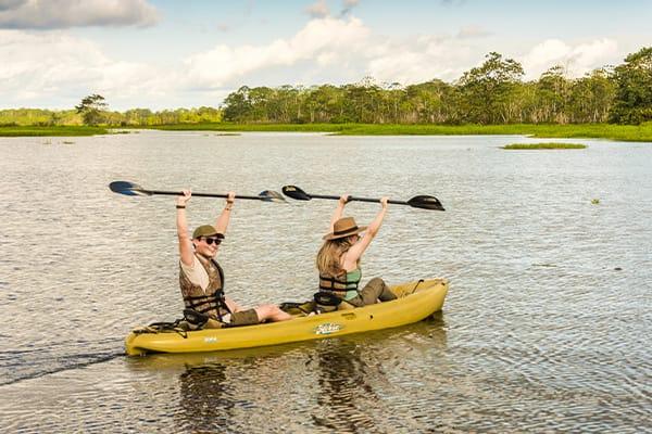 very cheerful photo pose on a kayak