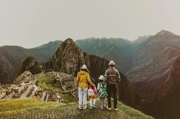 Family standing at Machu Picchu