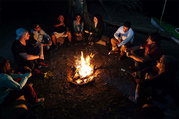 Campfire people having fun in the amazon