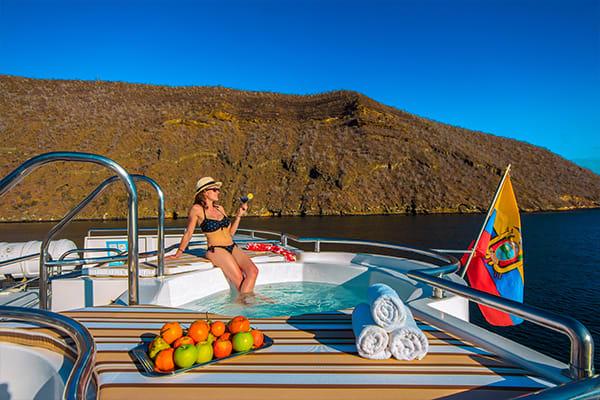 woman enjoying jacuzzi on treasure boat