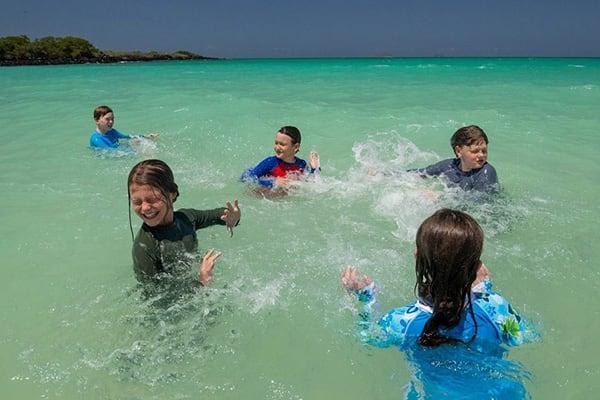 Kids splashing in ocean