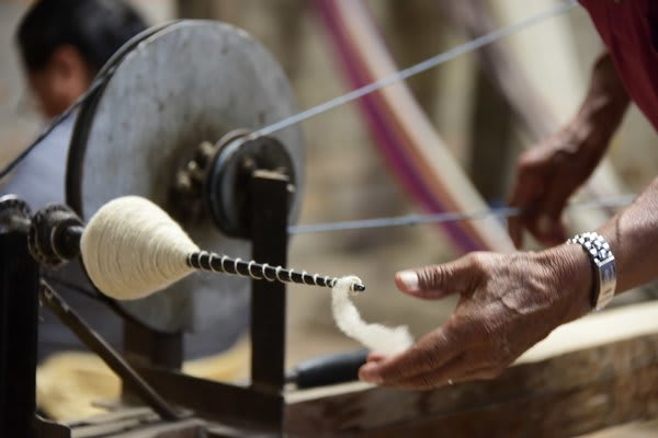 man weaver souvenir purchase