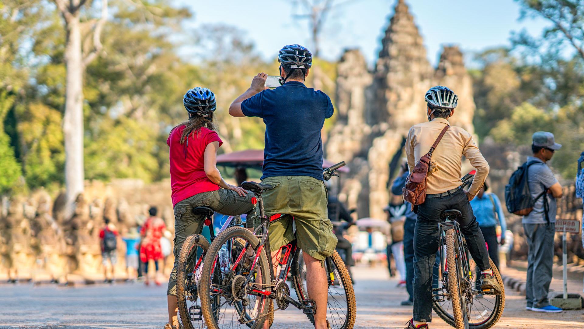 tourists biking in angkor wat