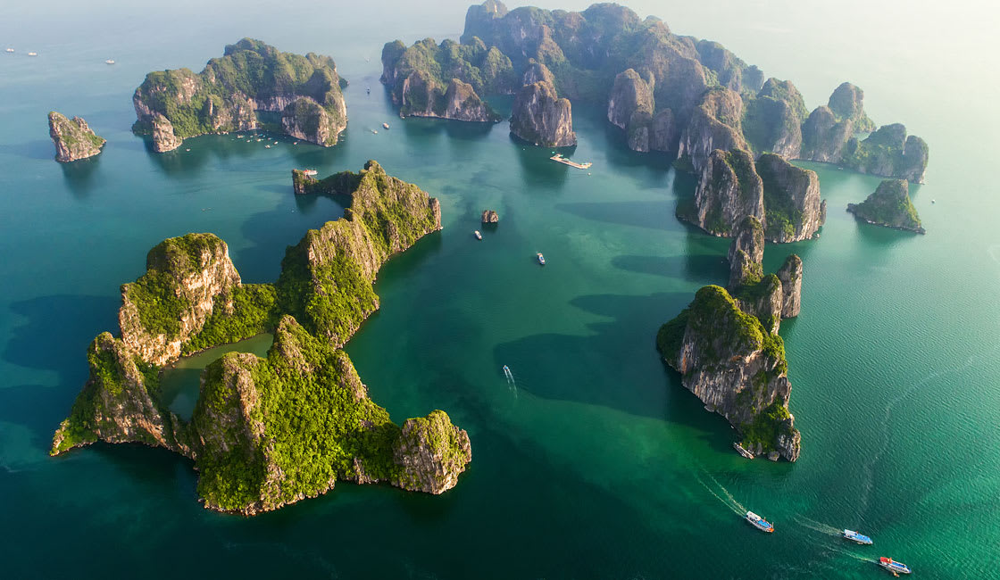 emerald waters and thousands of towering limestone islands