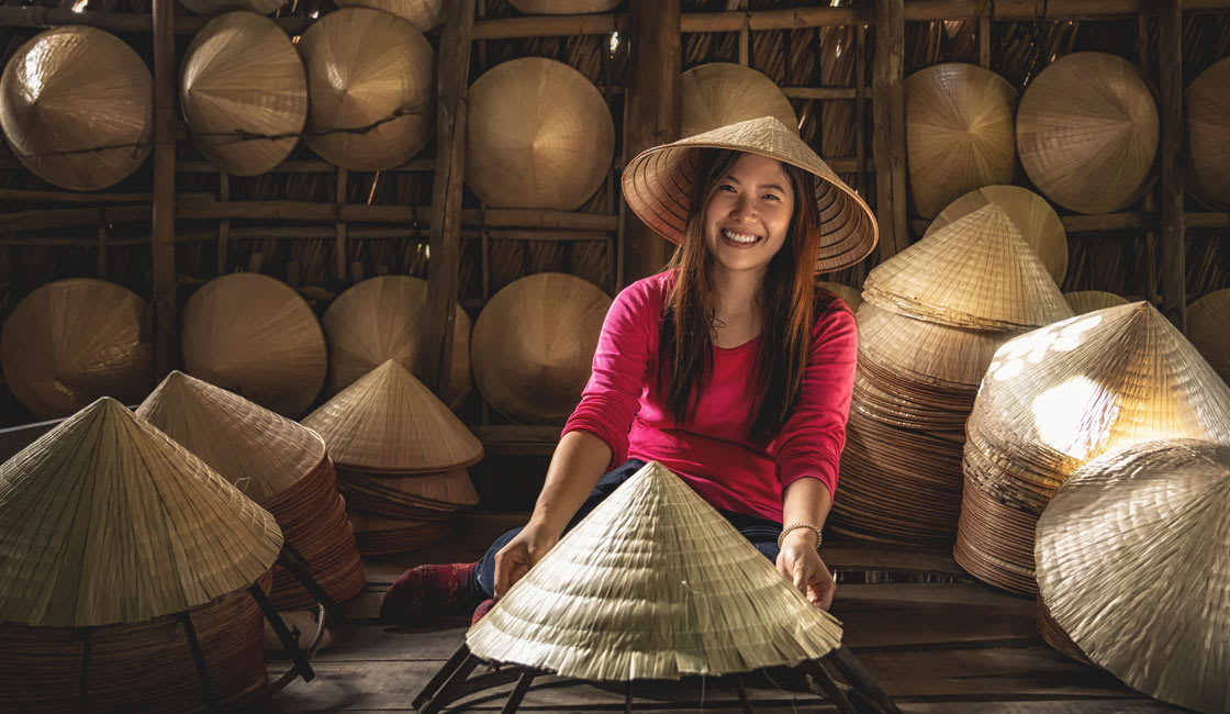 Young woman in a conical hat workshop