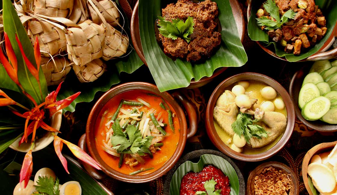 Table set with many Indonesian dishes