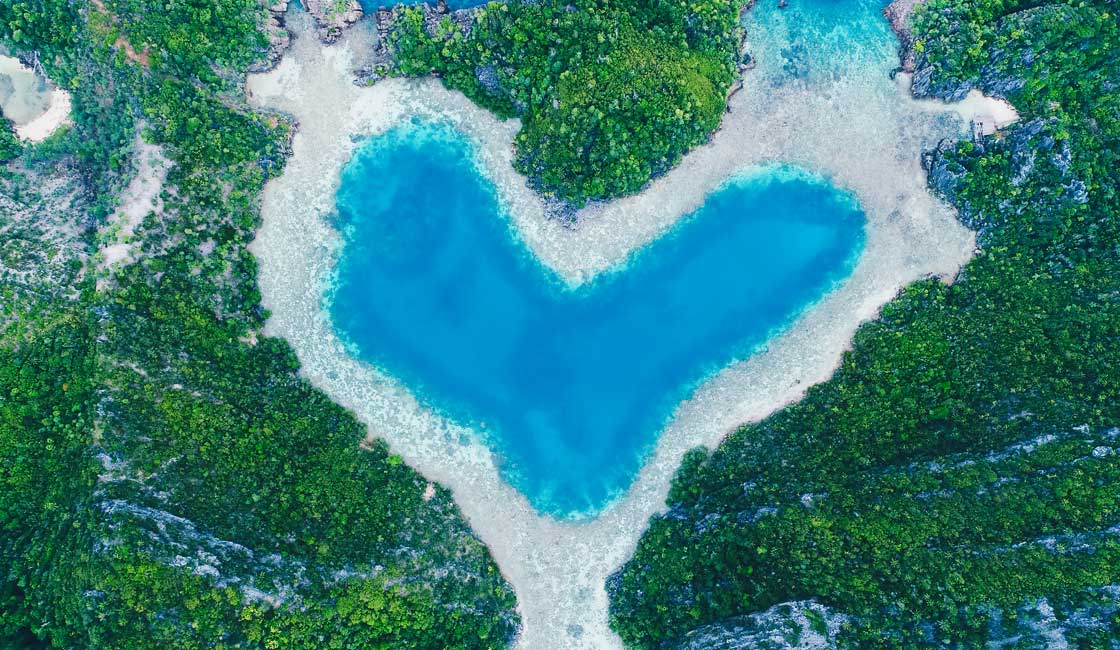 Coral reef and islands shaping water into a heart