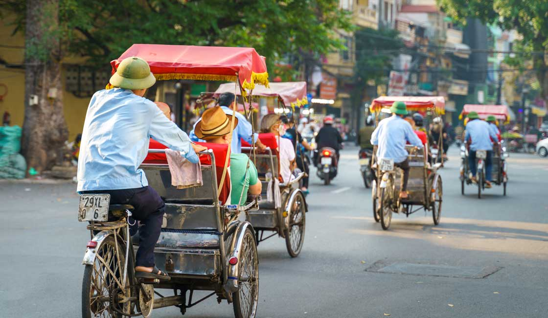 Cyclos in the streets of Hanoi