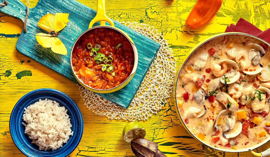 Various Brazilian foods on a yellow table