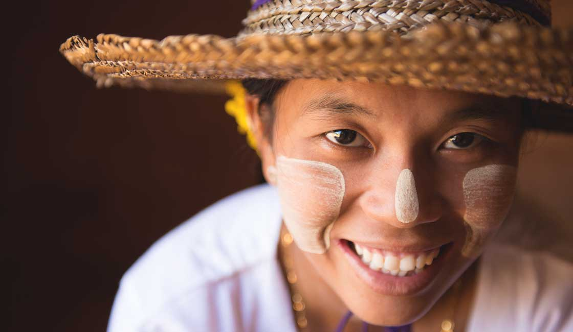 Young girl with thanaka paste on her face